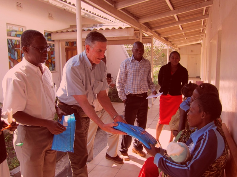 Jim Moore supplying bed nets to new moms.